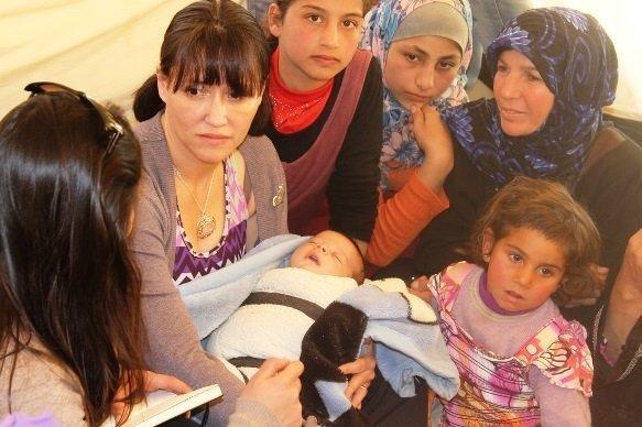 Kay volunteering in a Syrian regugee camp in Jordan.